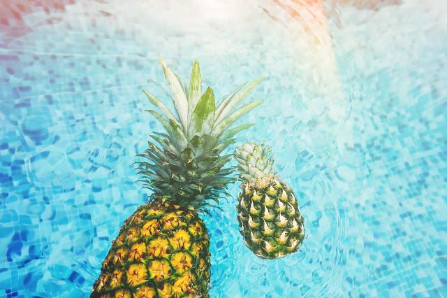 Pineapples Floating in Water